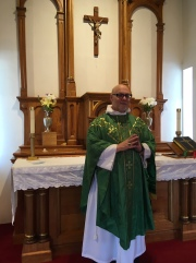 Father Richard in front of the altar
